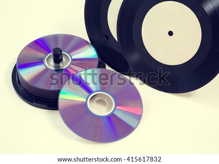 vinyl records and cd CD-R, DVD on a white background. isolated; retro style, vintage, old photo