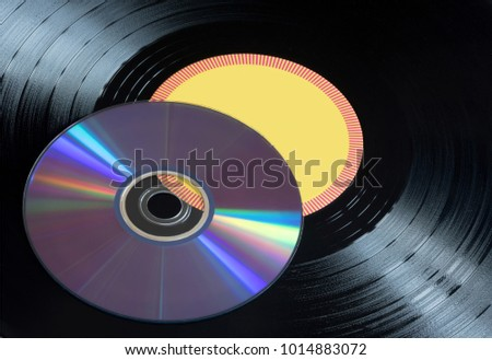 Vinyl records and CDs disks close up.