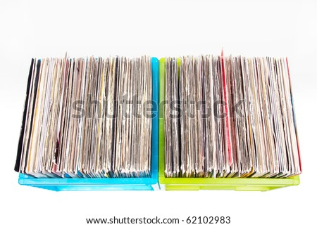Vinyl records in plastic boxes isolated on white, closed-up - stock photo