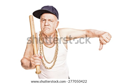 Violent senior in hip-hop clothes holding a baseball bat and giving a thumb down isolated on white background - stock photo