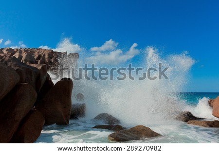 Violent Surf LaDigue Stones  - stock photo
