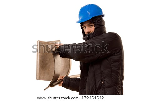Violent teenage hooligan in a hoodie and hardhat brandishing a wooden chair raising it above his shoulder as he prepares to attack, isolated on white - stock photo