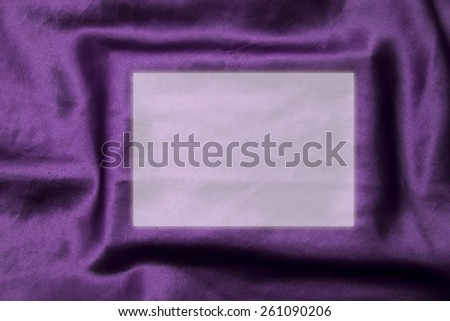 violet background abstract cloth of wavy folds of silk texture satin or velvet material or design of elegant curves purple material.  Satin material with place for your text in the box - stock photo