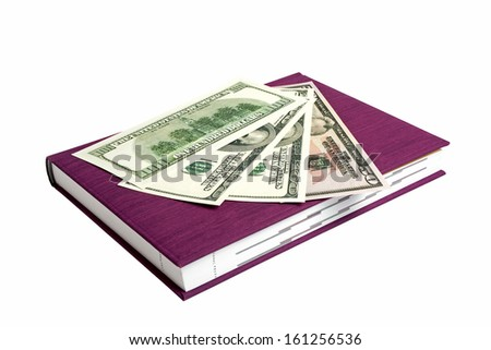 Violet book and dollars isolated on a white background