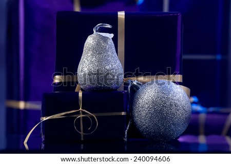 violet Christmas boxes,presents  and silver Xmas decoration, silver pear, silver ball - stock photo