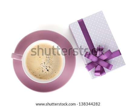 Violet coffee cup and gift box with bow. View from above. Isolated on white background - stock photo