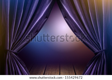 violet curtains in theater with dramatic light