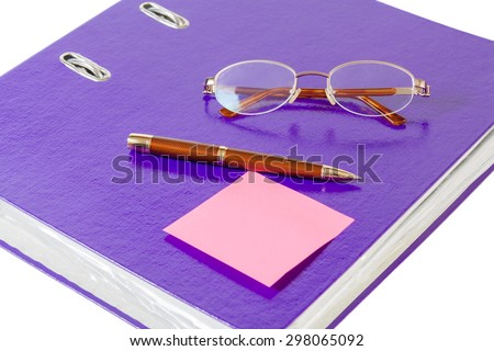 Violet folder with glasses and pen on white background - stock photo