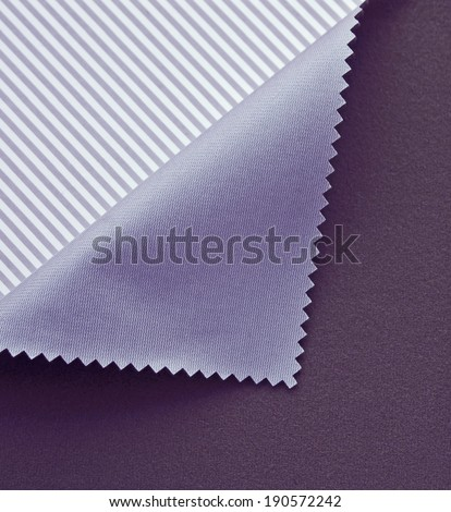 Violet polyester textile background - stock photo