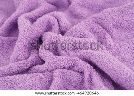 Violet towel texture as a background.