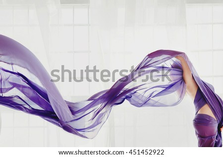 Violet veil flies over a lady in violet dress