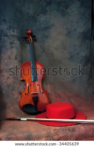 Violin and red cap - stock photo