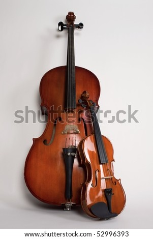 Violin and violoncello on a grey background - stock photo