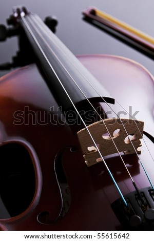 Violin in backlight over black acrylic. Studio photography. - stock photo