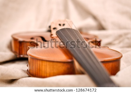 Violin isolated on beige background - stock photo