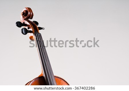 Violin isolated on grey background. - stock photo