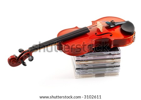 Violin lying down on stack of compact discs on white background, top angle view, horizontal, landscape orientation. Depicts a career in classical music.