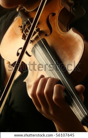 Violin music violinist classical instrument playing. Musician player Focus on hand. - stock photo