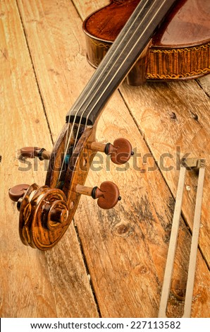 Violin neck and a tuning fork, a musical concept - stock photo