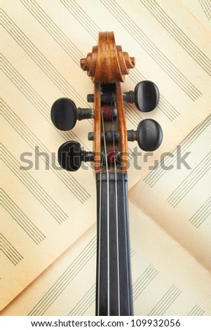 violin neck on old musical paper