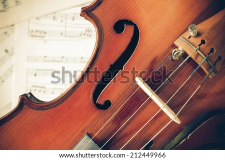 Violin on Music sheet, vintage photo style processed - stock photo