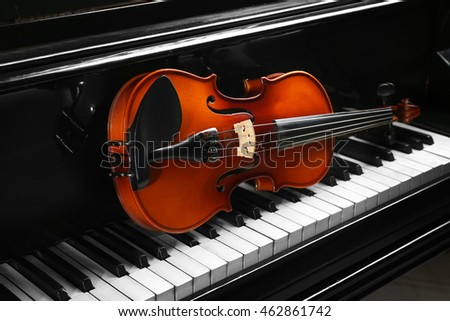 Violin on piano keys, closeup
