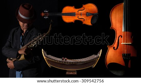Violin orchestra musical and Thai musical Alto xylophone instruments on black background - stock photo