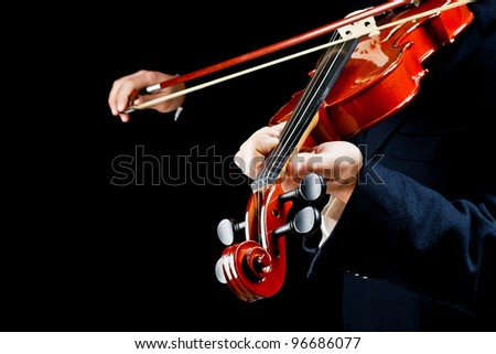 violin played by the musician - stock photo