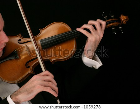 Violin player close up on black - stock photo