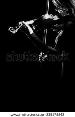 Violin player violinist Music instrument of orchestra Playing violin isolated on black - stock photo