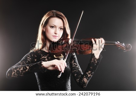 Violin player violinist music performer playing violin classic musician - stock photo