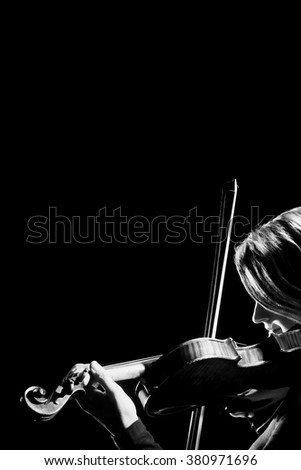Violin player violinist playing classical music instrument - stock photo