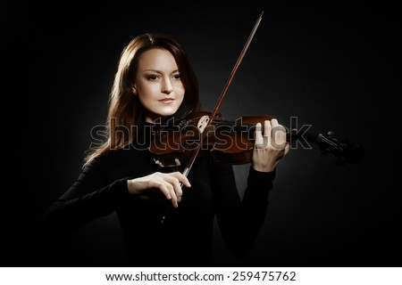 Violin player violinist woman playing violin musician with music instrument - stock photo