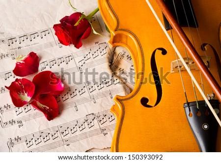 Violin sheet music and rose black composition still life music - stock photo
