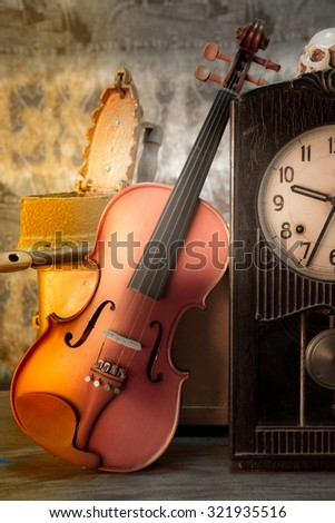 violin - still life with old clock