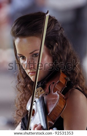 Violinist in performance - teen - stock photo