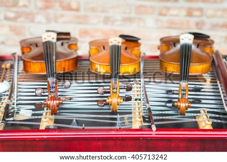 Violins and cimbalom. Selective focus. - stock photo