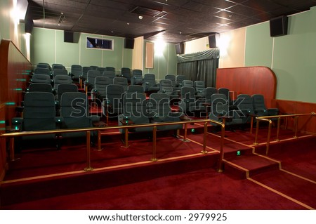 VIP Hall of a cinema and lines of green armchairs