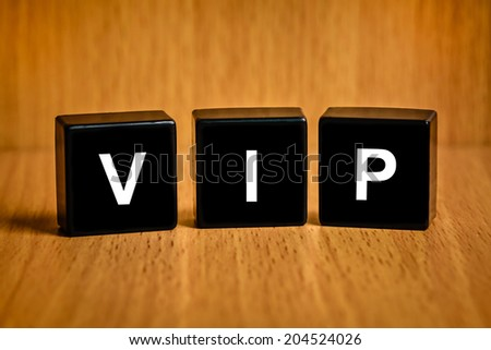 VIP or very important person text on black block - stock photo