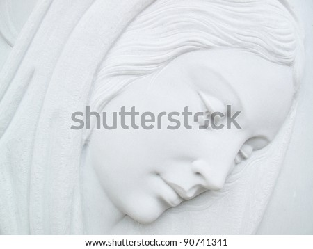 virgin mary on white marble tombstone - stock photo