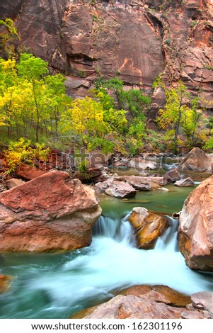 Virgin River waterfall through large boulders in Zion Canyon of Utah - stock photo