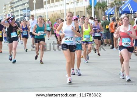 VIRGINIA BEACH, VIRGINIA-SEPTEMBER 2: Runners compete in the Rock N Roll Half Marathon on September 2, 2012 in Virginia Beach, Virginia - stock photo