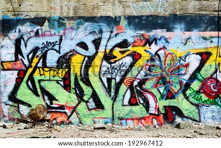 VIRGINIA CITY, NEVADA - APRIL 1, 2009:  Several years worth of graffiti on a wall at the site of an abandoned 100 year old gold and silver cyanide mill and smelter named American Flats. - stock photo