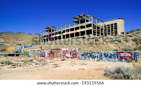 VIRGINIA CITY, NEVADA - APRIL 1, 2009:  Several years worth of graffiti on the remains of the abandoned 100 year old American Flats gold and silver cyanide mill and smelter. - stock photo