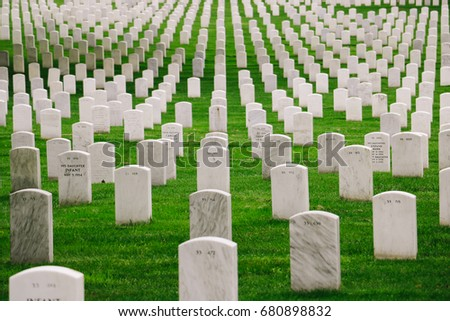 VIRGINIA, USA - CIRCA MAY 2017: White gravestones at the Arlington National Cemetery, a United States military cemetery in Arlington County, Virginia.