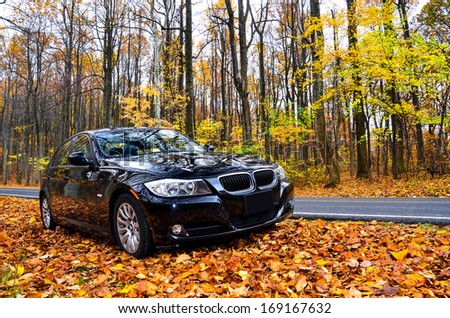 VIRGINIA, USA - OCTOBER 20, 2012: Photo of BMW 3 Series at skyline drive in Virginia, USA. The BMW 3 Series is a compact executive car manufactured by the German automaker BMW since May 1975. - stock photo
