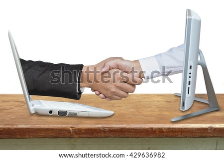 Virtual handshake. Internet business concept on wood table.