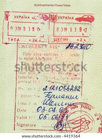 visa and stamps romania in german passport - stock photo