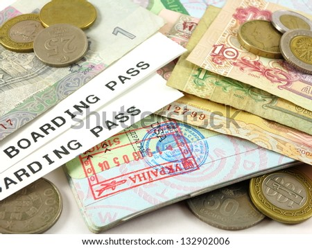 Visa stamp, boarding passes, foreign currency and coins - stock photo