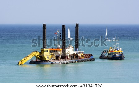Visby, Sweden - April 2016 : Dredging the ocean floor outside Visby harbor to start build a new pier for cruising ships on the island of Gotland in the Baltic sea in Sweden - stock photo